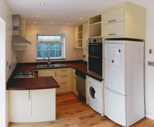 U-shaped custom made solid wood kitchen