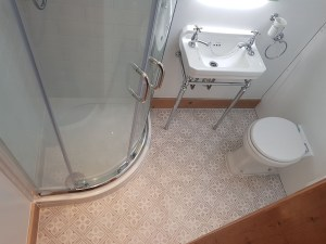 Quadrant Shower Enclosure with traditional basin and stylish tiles