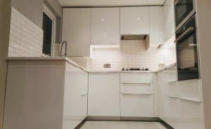 U-shaped kitchen with built-in oven and microwave
