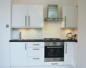 small Ikea white kitchen with oven and hob